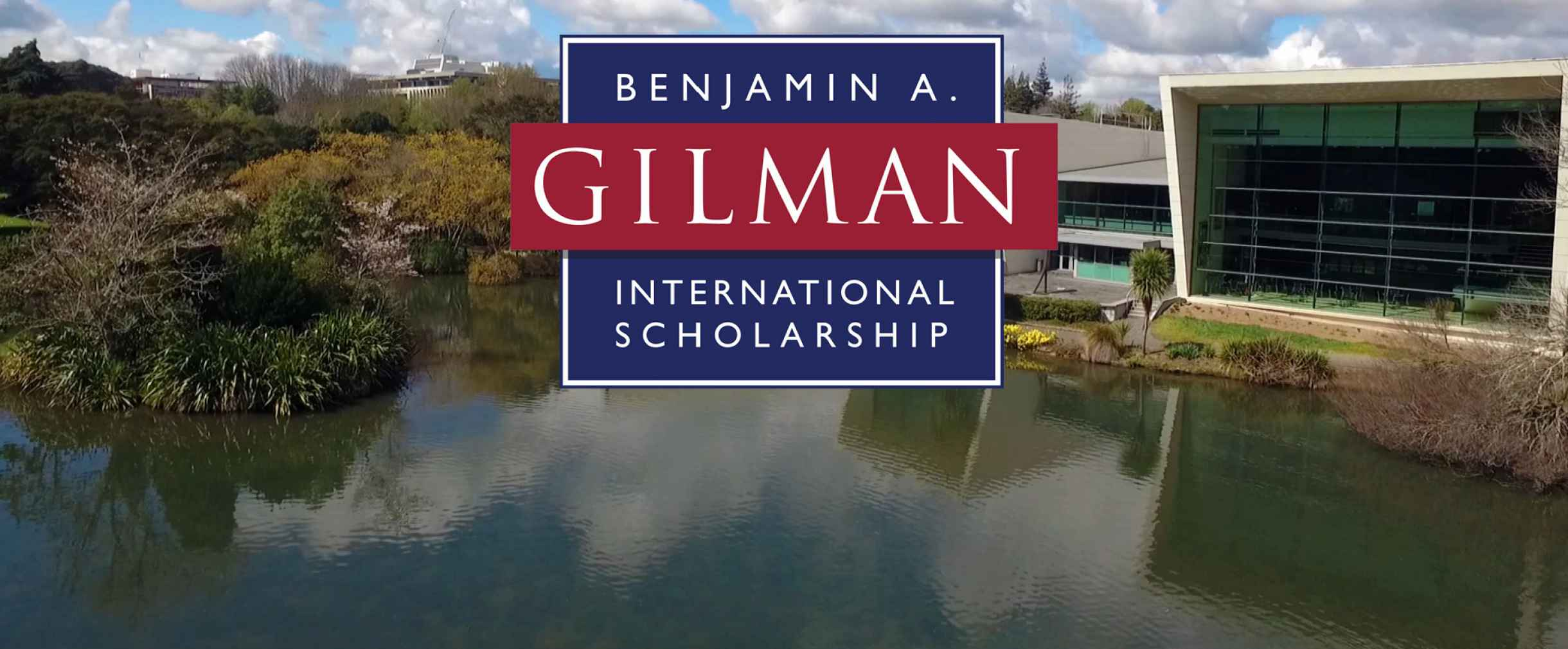 Background contains a lake with buildings along the shore and foreground contains the logo for Benjamin A. Gilman International Scholarship